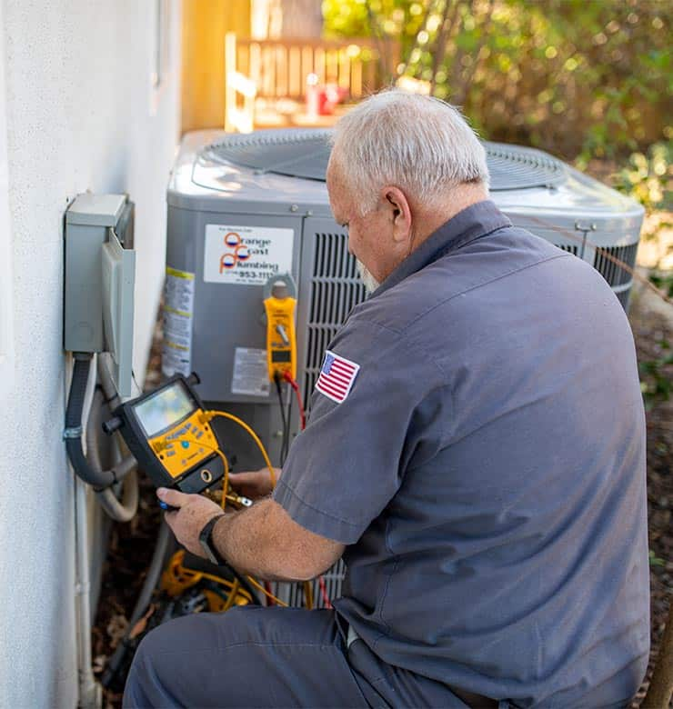 technician inspecting home heating and air conditioning system