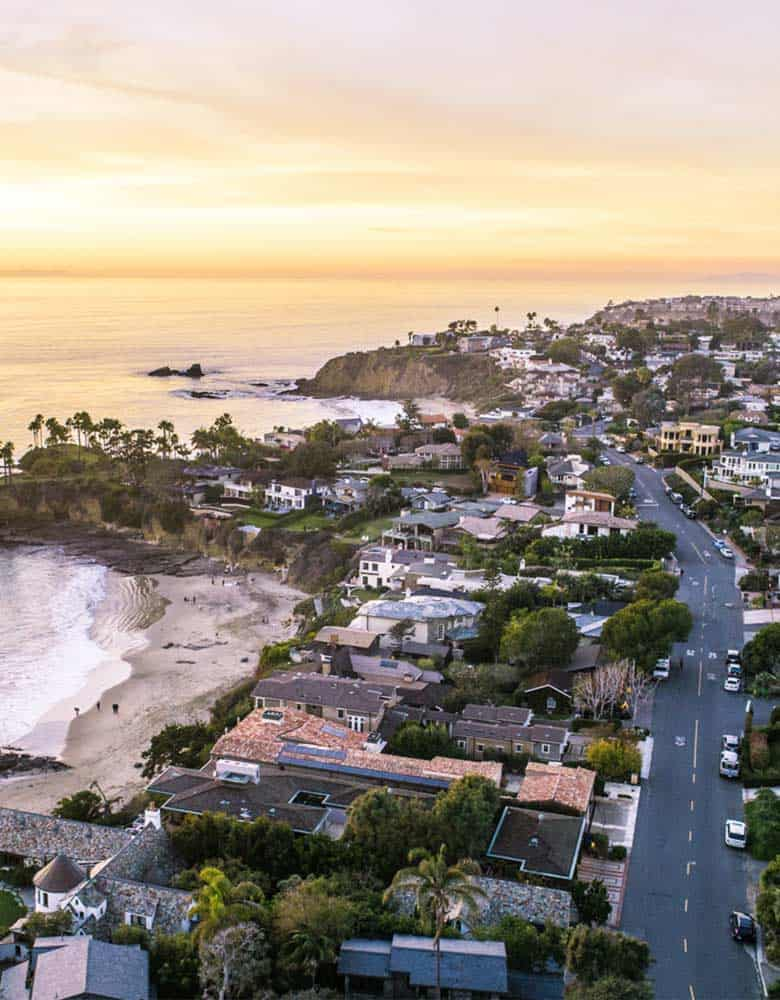 laguna beach neighborhood homes alongside beach shore